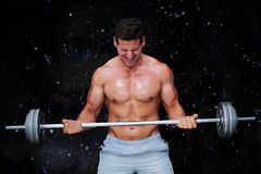 Composite image of bodybuilder lifting barbell Royalty Free Stock Image