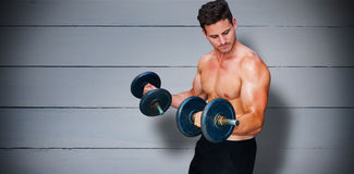 Composite image of bodybuilder lifting dumbbell Royalty Free Stock Images