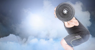 Composite image of bodybuilder lifting heavy barbell weights Royalty Free Stock Photography