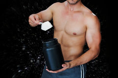 Composite image of bodybuilder with protein powder Stock Images