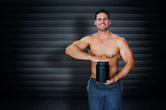 Composite image of bodybuilder with protein powder Stock Photo