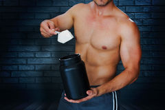 Composite image of bodybuilder with protein powder Stock Image