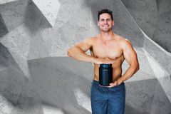 Composite image of bodybuilder with protein powder Royalty Free Stock Photography