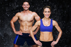 Composite image of bodybuilding couple Royalty Free Stock Photo