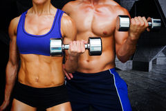 Composite image of bodybuilding couple Stock Photo