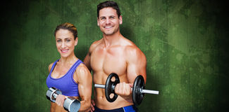 Composite image of bodybuilding couple Royalty Free Stock Images