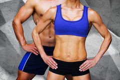 Composite image of bodybuilding couple. Bodybuilding couple against grey angular background Stock Image