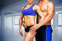 Composite image of bodybuilding couple Royalty Free Stock Photos