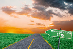 Composite image of 2015 in bold grey. 2015 in bold grey against road on grass stock illustration