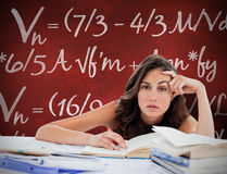 Composite image of bored student doing her homework. Bored student doing her homework against desk Royalty Free Stock Photos