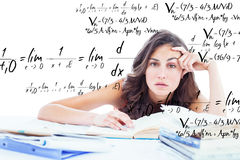 Composite image of bored student doing her homework. Bored student doing her homework against maths equation Royalty Free Stock Photos