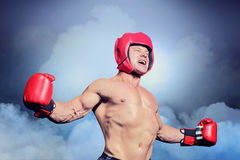 Composite image of boxer with arms outstretched against black background stock image