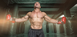 Composite image of boxer with arms outstretched Royalty Free Stock Image