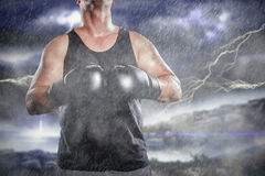 Composite image of boxer in boxing gloves laughing Royalty Free Stock Image