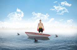 Composite image of boxer standing in a sailboat Stock Photography