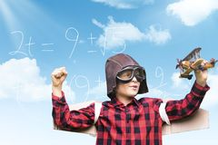 Composite image of boy in aviator cap holding toy airplane stock photos