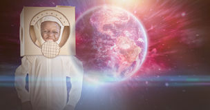 Composite image of boy is dessing up as an astronaut Stock Image