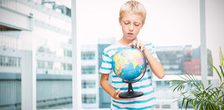 Composite image of boy looking at globe Royalty Free Stock Image