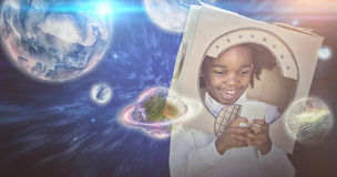 Composite image of boy playing as an astronaut Stock Image