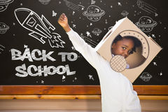 Composite image of boy playing as an astronaut in a park Royalty Free Stock Photography