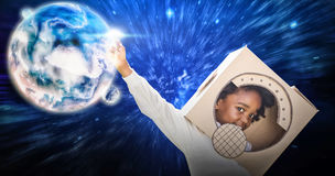 Composite image of boy playing as an astronaut in a park Royalty Free Stock Images
