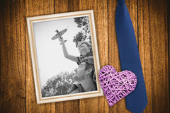 Composite image of boy with toy aeroplane sitting on fathers shoulders Stock Image