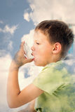 Composite image of boy using asthma inhaler in hospital Royalty Free Stock Image