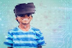 Composite image of boy using a virtual reality device Royalty Free Stock Photos