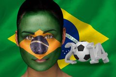 Composite image of brasil football fan in face paint