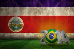 Composite image of brazil world cup 2014. Brazil world cup 2014 against costa rica flag in grunge effect Stock Photos