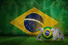 Composite image of brazil world cup 2014. Brazil world cup 2014 against brazil flag in grunge effect Stock Image