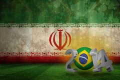 Composite image of brazil world cup 2014. Brazil world cup 2014 against iran flag in grunge effect Royalty Free Stock Photography