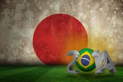 Composite image of brazil world cup 2014. Brazil world cup 2014 against japan flag in grunge effect royalty free illustration