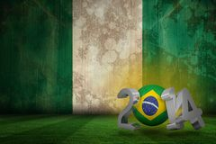 Composite image of brazil world cup 2014. Brazil world cup 2014 against nigeria flag in grunge effect Royalty Free Stock Photography
