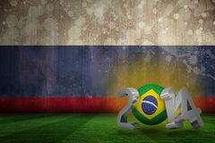 Composite image of brazil world cup 2014. Brazil world cup 2014 against russia flag in grunge effect Stock Images