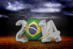 Composite image of brazil world cup 2014. Brazil world cup 2014 against stormy sky over field with lightning Royalty Free Stock Image