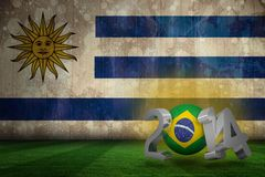 Composite image of brazil world cup 2014. Brazil world cup 2014 against uruguay flag in grunge effect Royalty Free Stock Images