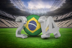 Composite image of brazil world cup 2014. Brazil world cup 2014 against vast football stadium with fans in white Stock Photography