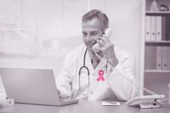 Composite image of breast cancer awareness ribbon Stock Photography