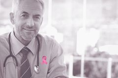 Composite image of breast cancer awareness ribbon stock images