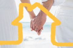 Composite image of bride and groom holding hands close up Royalty Free Stock Images