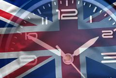 Composite image of the British flag and a clock royalty free stock image