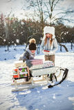 Composite image of brother and sister keeping presents on sled Royalty Free Stock Photo