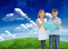 Composite image of brother and sister learning their lesson together Royalty Free Stock Image