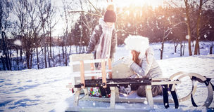 Composite image of brother and sister taking presents by sledge Royalty Free Stock Images