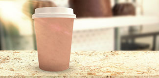 Composite image of brown cup over white background Stock Image