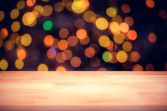 Composite image of a brown parquet. A brown parquet against close-up of christmas lighting Stock Image