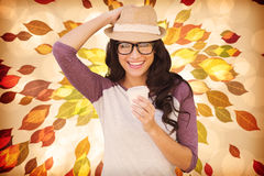 Composite image of brunette with disposable cup Stock Photography