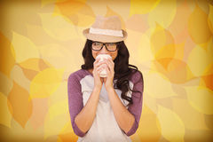 Composite image of brunette with disposable cup Stock Photos