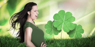 Composite image of brunette in green tshirt Stock Image